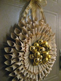 Rolled Book Page Wreath Tutorial by all things paper, via Flickr Kind of like this...maybe done with christmas wrapping paper  Paper craft, christmas ornaments