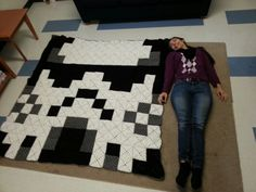 """Stormtrooper blanket. 196 crocheted granny squares 14 squares by 14 squares. It took me six months to make. It's the size of a full bed. As reference I am 5' 5"""". I attached them by slip stitching. My boyfriend loved getting it for Christmas."""