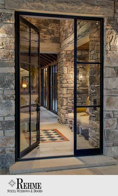 Black wrought iron and crisp lines make these oversized doors a
