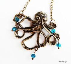 Hier biete ich eine wunderschöne Octopuskette im Vintage Stil mit petrolfarbenen Glasperlen verziert.     Länge der Kette ca. 80cm. Kette auch länger