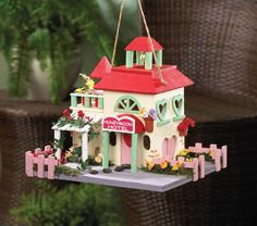 Love is in the air, and with this birdhouse, it can also be hanging in your yard! The Honeymoon Hotel has a vacancy for a couple of sweet little lovebirds that will surely enjoy the charming heart-shaped windows, the pink picket fence, and the faux flowers in bloom. #birdhouse #freeshipping