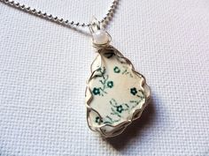 Tiny green flowers Seaham sea pottery and white pearl wire wrapped necklace Green Flowers, Pearl White, Wire Wrapping, Pottery, Pendant Necklace, Sea, Pearls, Silver, Handmade