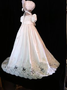 Oriana V is the latest generation of my most popular gown. The lace is applied to the hem of the full silk skirt bodice and bonnet. This is