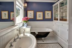 Add Bathroom Cabinet for Storage Purposes Bath: Antique Cabinet And Grohe Faucet Plus Beveled Mirrors With Black Claw Foot Tub In Blue Bathroom Plus Blue Walls And Double Hung Windows With Hexagon Tile Also Pedestal Sink Plus Roman Shades ~ idobrich.com Bathroom Inspiration