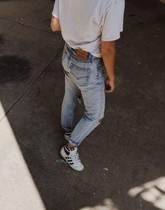 Vintage Levis 501, vintage Adidas top ten hi kicks & worn out shirt. Via Mija