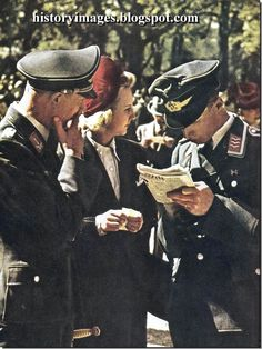 A French women with two Luftwaffe officers at Paris' Longchamp race course. Paris Under German Occupation During WW2: Color Pics By Andre Zucca