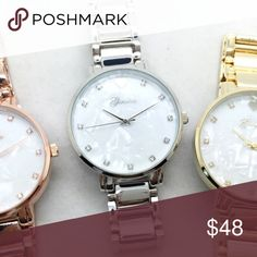 Mother of Pearl Water Resistance incased w/ Stainless Steel, Big Faced BF Style Watch. (One Available)   .Ask About Custom Bundles.  .Poshmark Rules Only. No Trades.  .Additional Pics Available as Time Allows. Geneva Platinum Accessories Watches