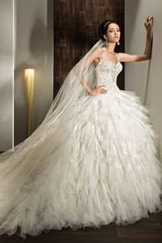 Feathered bridal gowns