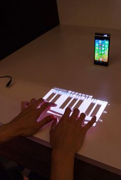 The Lenovo Smart Cast phone takes the concept of the digital piano to the next level with it's laser projection keyboard