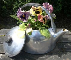tea kettle up cycled flower pot.