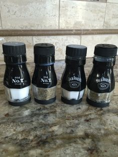 Jack Daniels salt and pepper shakers made from the top of the bottle neck