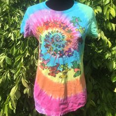 Grateful dead bears shirt. Tye dye Fantastic grateful dead bears  tee. Tye dye. No size listed. Bought at sunshine day dreams. Has small hole inside shirt where tag was removed. You can't see this when wearing. Soft and comfortable. Under bear it says GDB1997 as far as I can see. Perfect for a summer festival. Fits size small. Grateful dead Tops Tees - Short Sleeve