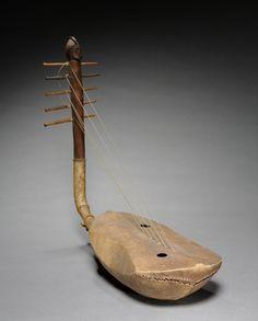 Harp, 1900s      Central Africa, Democratic Republic of the Congo, Mangbetu, 20th century      wood, Overall - l:63.60 cm (l:25 inches).