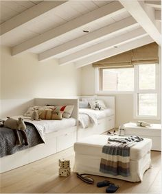 Beds against long wall, windows