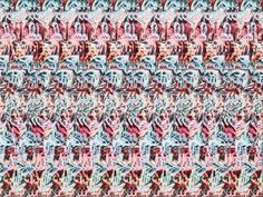 Magic Eye 3 D Illusion -- there are 2 different images--you have to focus differently to see 4 hearts in the 4 corners, or the word LOVE repeated vertically across the picture