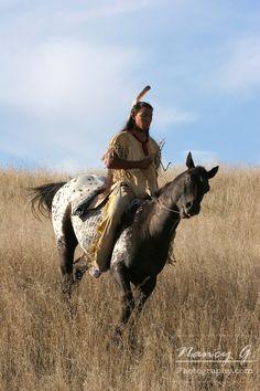 A Native American man on horseback riding the prairie of South Dakota. Nancy Greifenhagen Photography
