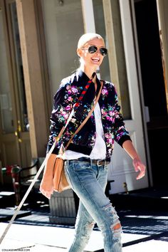 floral jacket with light tan leather bag. I like the floral concept of the jacket.