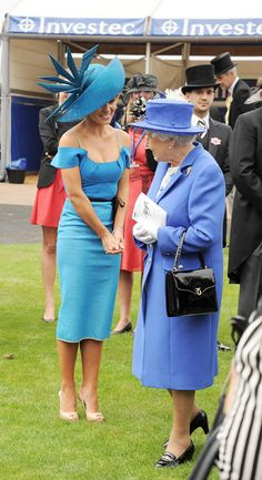 All change for Katherine Jenkins after stunning trackside performance - She sang the National Anthem. Picture 6.Meeting the Queen