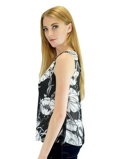 """This floral black and white tank top looks great paired with skirts or jeans for a polished autumn look. Whether it be walking in the park, lounging at home, or shopping with friends, this blousewill take you anywhere you want to go this fall. Just put it on and let your heart take you where it will lead!  Relished Exclusive 100% Polyester Machine wash Imported Style #615S21 Length: 23"""" from shoulder. Measurements taken from a size Small."""
