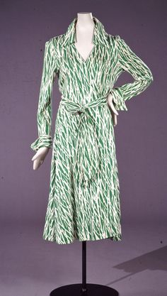 Wrap dress, Diane von Furstenberg, ca. 1976. Diane von Furstenberg's reputation began with one dress, the wrap. Introduced in 1973, von Furstenberg's signature dress is a one-piece wrap style that crosses in the front and ties at the waist. Figure hugging and made of synthetic or silk jersey knit in bright, colorful prints, the dress was meant to be tightly wrapped.