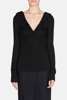 Under the creative direction of Georgia Lazzaro, Protagonist is expanding in scope while remaining true to signature subtleties of form, fit, and fabrication. The resort 2017 collection addresses a woman's shifting sartorial needs and desires with pieces like this versatile sweater. Made of ribbed Italian viscose, it can be worn as a button-back crewneck or a button-front v-neck. Extended long sleeves balance the sleek silhouette.
