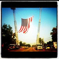 This flag being held up by two fire trucks was flown all day today!!! 10 years ago today, we were attacked... Stand strong America... We will never forget! God Bless!! Thank you Sulphur Louisiana ... For standing proud !!