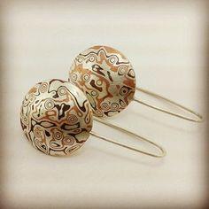 Mokume gane earrings by Joalheria Sperancini.