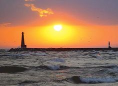 This is my hometown, Muskegon, MI. sunset over lake michigan. Love this place!!!! So many summer days and nights spent there!! :)