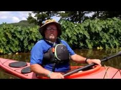Phil Walton owner of Unphiltered Kayaking on the water talking professio...