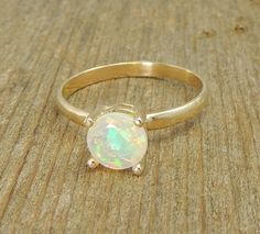 Handmade Opal Engagement Ring 14k Gold, Simple Engagment Ring, Traditional, Natural Ethiopian Opal. $350.00, via Etsy.