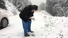 November 19, 2015 - You've lived 100 years, seen a century's worth of winters, but it's still fun to get out and dig in to make snowballs for throwing. You need have no more reason than the sheer pleasure of it, and the smiles on this lovely mother's face says it all.  Merry Merry Christmas (or whatever you follow) to her, her son, and to all the people who are with me on this magnificent Earth as we sail around the sun.