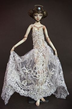 the porcelain Bride of Frankenstein doll on which the drawing is based ... while these dolls are totally creepy, they're also quite beautiful in their way too, check them out