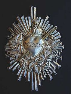 Made of tin or silverplate metal, milagros were produced in Spain, Germany and Mexico. Many are used in Christian church services and then hung in the owner's home. This Italian version is valued at about $125 and is from the early 20th century. Photo courtesy cornioli, an eBay seller from Milan, Italy