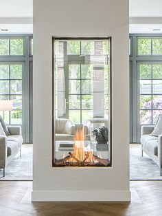 see-through fireplace vertical fireplace designer fireplace modern fireplace mod. - see-through fireplace vertical fireplace designer fireplace modern fireplace modern design - Home Fireplace, Fireplace Design, Fireplace Modern, Double Sided Fireplace, Fireplace Outdoor, Fireplace Ideas, Fireplace In Kitchen, Candle Fireplace, Contemporary Fireplaces