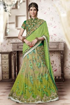 Look your feminine best by cladding into this remarkable wedding wear embroidered designer lehenga saree. This mehendi green color designer outfit is decorated