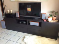 IKEA Besta TV Stand. Two personalized 120cm units in black-brown. Each composed by two drawers, door and an open shelf. Total 242€