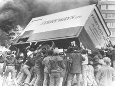 Rioters turn a burning lorry into a barricade in the Divis Flats area of Belfast, after violence erupted following the death of Irish Republican Army hunger striker and Member of Parliament Bobby Sands in the Maze prison. (Photo by Keystone/Getty Images). 6th May 1981