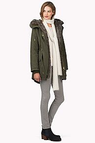 Classic parka made from cotton with a brushed cotton lining in a check pattern. Fully covered zip at front, ribbed storm cuffs and a drawstring waistband for an adjustable fit. Faux fur lining in the hood. <br/><br/>Our model is 1.76m and is wearing size S Tommy Hilfiger coat.