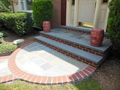Front walkway of cut flagstone set on concrete with a soldier border.