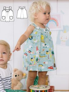 A dose of extra cuteness! White piping decorates the front buttoning band of this A-line dress.