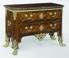Commode (Getty Museum)Unknown  French, Paris, 1710  Oak and walnut veneered with rosewood; gilt bronze mounts; rouge griotte de Félines marble top H: 2 ft. 9 1/2 in. x W: 4 ft. x D: 1 ft. 10 3/8 in.