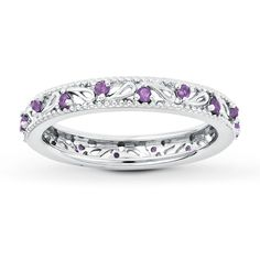 A sterling silver stackable band set with 16 amethysts inside two beaded edges.  Gently clean by rinsing in warm water and drying with a soft cloth.