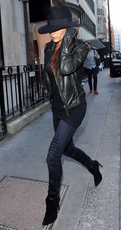 Accessorizing her fall outfit with a chic chapeaux, Victoria Beckham keeps it edgy in a black leather jacket.