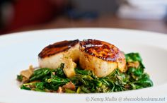 Seared Scallops with Apple Cider-Balsamic Glaze   remove seared scallops, add sauce and spinach mixture and reheat until liquid is reduced by half. plate scallops on spinach served with root veg puree.