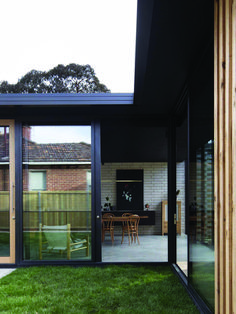 Doors, Exterior, Metal, and Sliding Door Type The extension sits on a burnished concrete slab with exposed concrete bricks along the main wall. Photo 2 of 15 in Breezy Courtyards Brighten Up a Dated Tasmanian Home Concrete Bricks, Exposed Concrete, Concrete Houses, Australian Architecture, Australian Homes, Australian Beach, Indoor Outdoor Living, Outdoor Decor, Modern Door