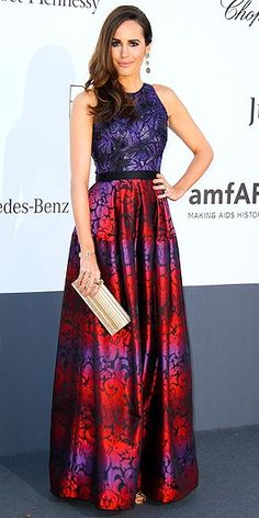 Louise Roe in a purple-and-red color combo Salamoun gown, which she styles with a Jimmy Choo clutch, long danglers and metallic sandals.
