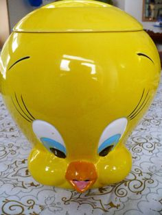 "This ceramic Tweety cookie jar is in excellent vintage condition with strong color. A few tiny areas on the eye and 'beak' need a touch up with paint. Marked Looney Tunes , ( sO3) , TM & Warner Bros. on the bottom. This is a welcome addition to any Tweety ,Warner Bros. Character Head, Looney Tunes or Cookie Jar Collection. Approximately 9 ½"" high with the lid. http://www.etsy.com/shop/VintageatElsiesPlace"