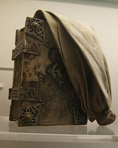Girdle book - Nuremberg 1471  The book was covered in a large piece of leather, which was tied in a knot at the top to be tucked under the girdle/belt as a way of carrying it