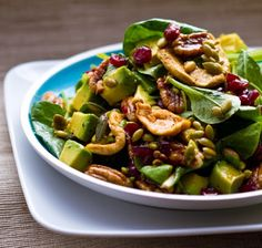 Fall Forward Salad with spinach, apple rings, cranberries, pecans and pumpkin seeds!