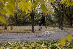 An enthusiast wearing historical dress rides high-wheel bicycles during the traditional 'Prague Mile' race on November 5, 2016 in Prague, Czech Republic. The Czech high-wheel bicycles club was founded in 1880 and its members meet up for the annual race.